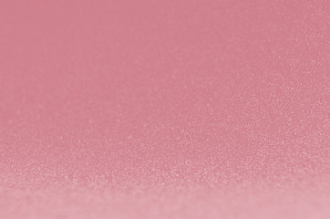 Pink glowing sparkling bokeh background for elegance rich luxury holiday design.
