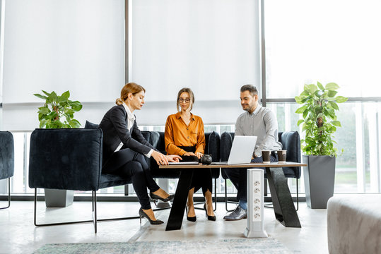 Young couple talking with financial consultant at the luxury bank office. Investment or lending concept for a young family