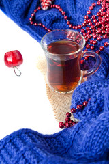 Hot christmas beverage black tea in turkish cup with new year decorations and plaid on white