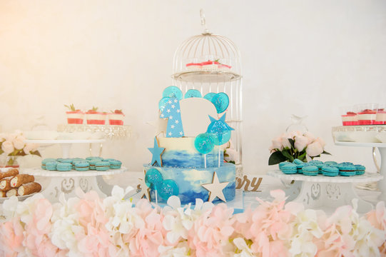 close up photo a blue 3 tier birthday cake for 1 year boy in a candy bar