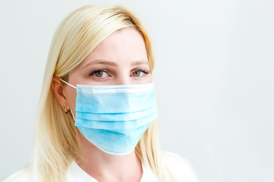woman with a medical mask for protection again influenza. Shallow depth of field. Copy space for your text.
