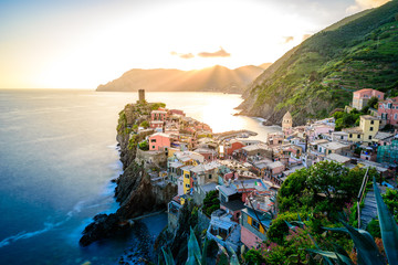 Fototapeten Ligurien Vernazza - Village of Cinque Terre National Park at Coast of Italy. Beautiful colors at sunset. Province of La Spezia, Liguria, in the north of Italy - Travel destination and attraction in Europe.
