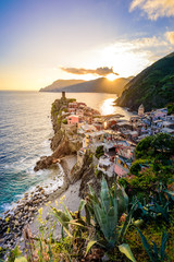 Vernazza - Village of Cinque Terre National Park at Coast of Italy. Beautiful colors at sunset. Province of La Spezia, Liguria, in the north of Italy - Travel destination and attraction in Europe.