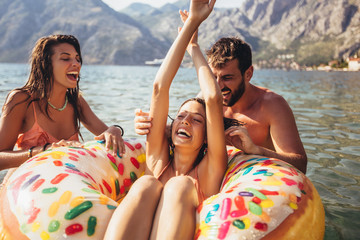 Young trendy people having fun swimming in summer vacation
