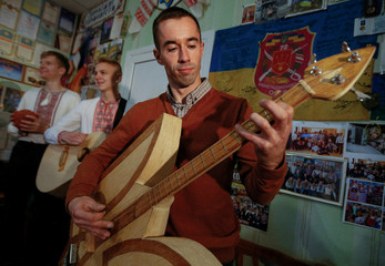 Ukrainian craftsman Senchukov plays a musical instrument made of safety matches in Zhashkiv