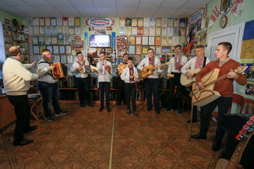 Members of a musical band play instruments made of safety matches during a rehearsal in Zhashkiv