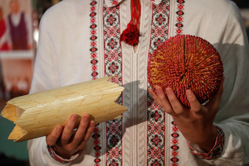 A member of a musical band plays instruments made of safety matches during a rehearsal in Zhashkiv