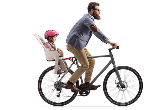 Man riding a bicycle with a little girl with a helmet inside a childs seat