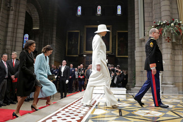 Prince Albert II of Monaco, Princess Charlene, Princess Caroline of Hanover and Princess Stephanie of Monaco arrive to attend a mass at Monaco Cathedral during the celebrations marking Monaco's National Day