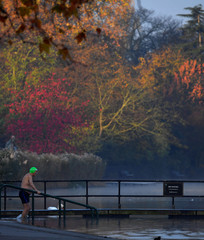 A swimmer prepares to enter the water during the early morning at the Serpentine lake in Hyde Park, London
