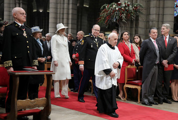 Prince Albert II of Monaco and Princess Charlene arrive to attend a mass at Monaco Cathedral during the celebrations marking Monaco's National Day
