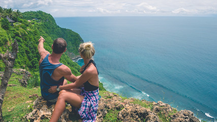 Couple of tourist of Nunggalan Beach near Uluwatu, Bali, Indonesia