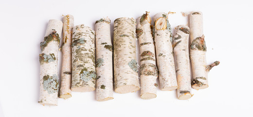 Tuinposter Brandhout textuur A pile of birch firewood on white background
