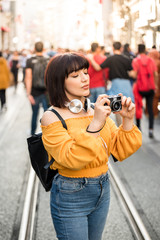 Cute girl takes phots with retro vintage camera