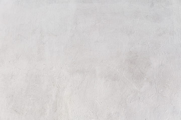 Rough white relief stucco wall texture background. blank for designers