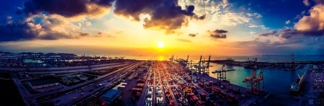 Modern Logistics,transportation of Container Cargo ship,Cargo plane,working crane bridge in shipyard. Distribution container terminal at dusk,international logistics, import-export business background