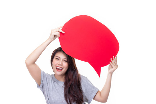 Attractive beautiful young asian woman smile and excited holding empty speech bubble isolated on white background.