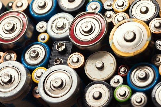 Used Alkaline batteries toxic waste recycling and ecology issues concept background