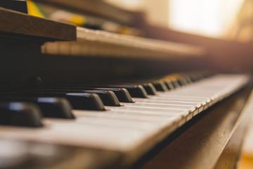 Closeup selective focus vintage piano keys.