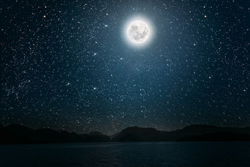 Wall Mural - moon against a bright night starry sky reflected in the sea