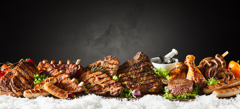 Panorama banner of grilled meat from a winter BBQ