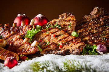 Grilled ribs and steaks in winter decorations