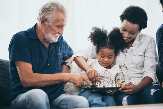 Happy people family concept laugh and have fun together with three different generations ages
