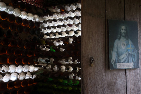 A view of a wall of a house built with bottles by farmer Ivone Martins, 50, to overcome a depression after losing a child, in Itaoca