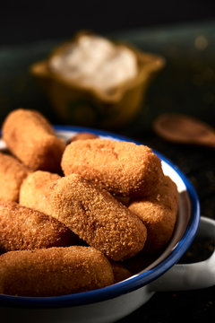 spanish croquettes on a rustic wooden table