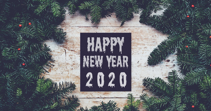 Happy new year 2020 graphic design in center