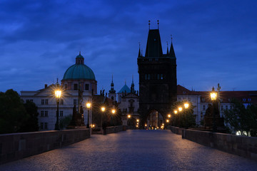 Prague, Charles Bridge in night. Lights on the bridge, built in medieval times. Twilight view of Prague with blue sky. Travelling in Europe. Town Prague, capital of Czech Republic, old city.
