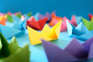 Fleet Of Authentic Origami Boats On Blue Background