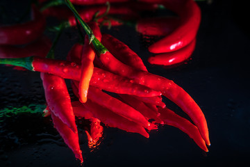 Canvas Prints Hot chili peppers Fresh organic chili peppers with reflection on shiny black background