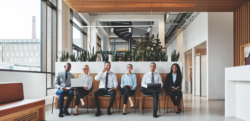 Diverse businesspeople working in the reception area of an offic