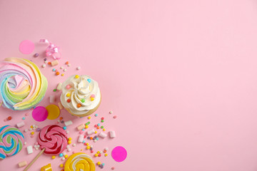 Flat lay composition with cupcake on pink background, space for text. Birthday party