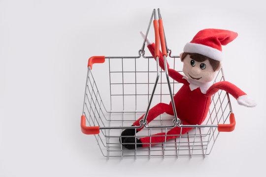 Christmas shopping - elf toy in empty shopping basket