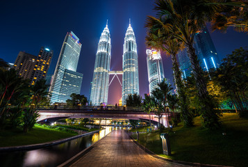 Kuala Lumpur, Malaysia. April 28, 2018: Night view of Petronas Twin Towers KLCC, the most attractive place in Malaysia. Night sky with highest buildings.