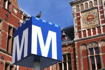 AMSTERDAM, NETHERLANDS - JULY 9, 2017: Metro sign in Amsterdam, Netherlands. Amsterdam Metro serves 71 million annual rides (2016).