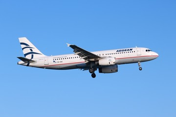 LARNACA, CYPRUS - MAY 17, 2014: Aegean Airlines Airbus A320 lands in Larnaca International Airport. It is the largest Greek airline and carried 6.9 million passengers in 2013.