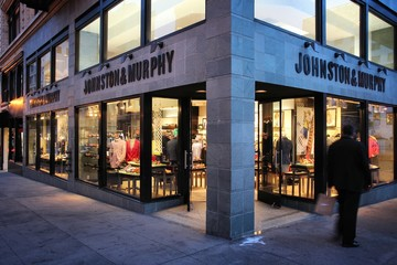 SAN FRANCISCO, USA - APRIL 8, 2014: People walk by Johnston and Murphy fashion store in San Francisco, USA. Annual retail sales reached USD 4.785 trillion in the United States in 2015.