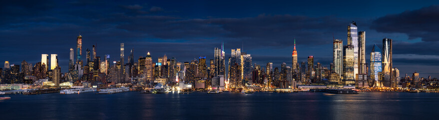 New York City (Manhattan) panoramic view at dusk from the Hudson River. The view includes the skyscrapers of Midtown West (Hudson Yards redevelopment project). NYC, NY, USA