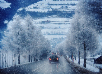 Car traffic on a mountain road during a snow storm on the Austrian Alps