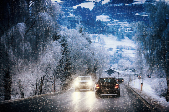 Car traffic on a mountain route during a snow storm on the Austrian Alps
