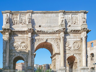 A fragment of the arch of Constantine at the iconic Colosseum in Rome, Italy.