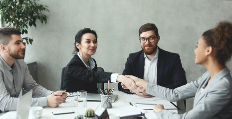 Fototapete - Business women shaking hands closing deal after meeting