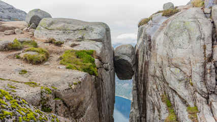 Kjerag Kjeragbolten above the Lysefjord. Norway's most beautiful landscape.