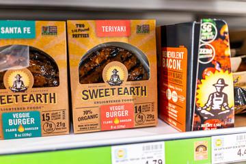 Basalt, USA - September 19, 2019: Supermarket grocery store shelf with price for vegan plant based veggie burger Sweet Earth brand in City Market Kroger