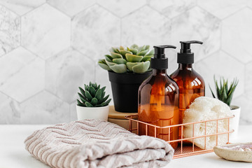 Türaufkleber Spa Soap and shampoo bottles and cotton towels with green plant on white table inside a bathroom background.