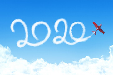 Happy New year 2020 concept on the background below cloudscape. Drawing by passenger airplane white vapor contrail in sky.