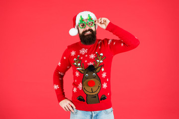 Sweater with deer. Hipster bearded man wear winter sweater and hat. Knitted sweater. Happy new year. Christmas spirit. Winter party outfit. Clothes shop. Buy festive clothing. Holidays accessories